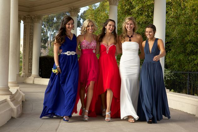 A group of teens wearing a selection of our prom dresses